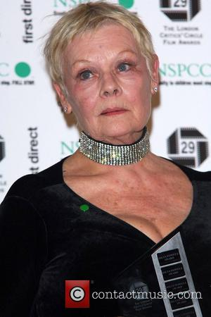 Dench Returns To Stage After Fall