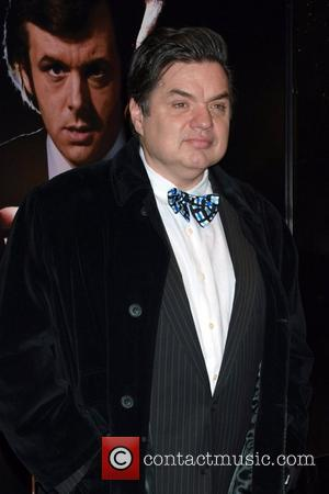 Oliver Platt  Kate Jennings Grant  at the premiere of 'Frost/Nixon' at the Ziegfeld Theatre New York City, USA...