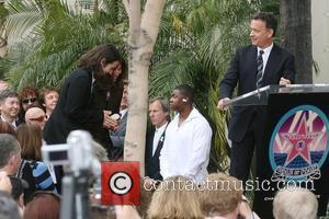 Dhani Harrison, George Harrison, Olivia Harrison and Tom Hanks