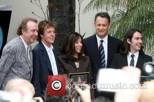 Eric Idle, George Harrison, Olivia Harrison and Tom Hanks