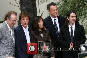 Eric Idle, Paul McCartney, Olivia Harrison, Tom Hanks and Dhani Harrison Beatle George Harrison posthumously honored with star on the...