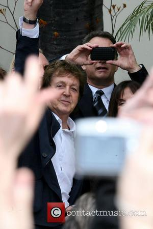 Sir Paul McCartney and George Harrison