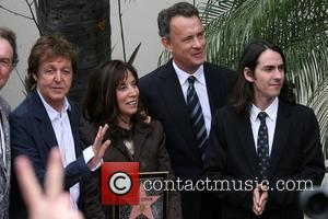Sir Paul McCartney, George Harrison, Olivia Harrison and Tom Hanks