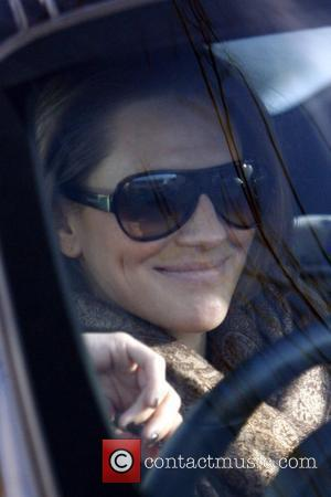 Georgie Thompson seen driving in her car. London, England - 26.01.09
