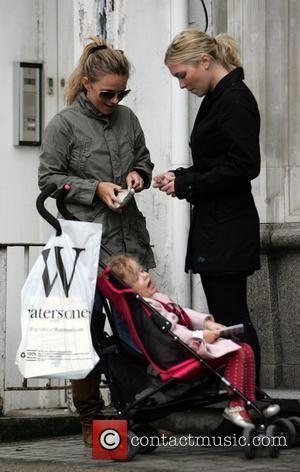 Geri Halliwell out and about with her daughter Bluebell Madonna, who is holding a Little Miss Busy children's book. London,...