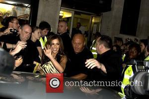 Cheryl Cole of Girls Aloud leaving Waterstone's in Piccadilly after signing copies of their book 'Dreams that Glitter: Our Story'....
