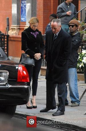 Kelly Rutherford and Robert John Burke