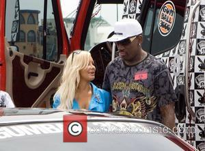 Dennis Rodman speaks to a model Gumball 3000 - Drivers get ready to start race at Santa Monica Pier Santa...