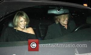 Nicky Whelan and David Spade leaving Elton John's Birthday party at Hamburger Hamlet Los Angeles, California - 27.03.09