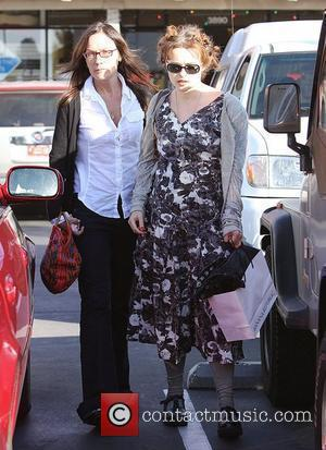 Helena Bonham Carter leaving a restaurant with a friend, carrying a Banana Republic shopping bag Los Angeles, California - 12.12.08