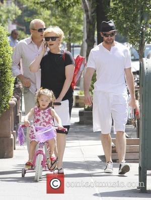 Hugh Jackman and his wife Deborra-Lee Furness take their daughter Ava Jackman out on her bike. New York City, USA...