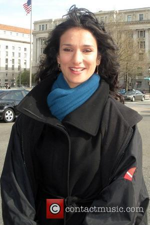 Indira Varma filming scenes outside the Willard Hotel for a pilot episode of a new television show called 'Inside The...