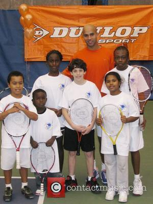 James Blake and children 'Serving up the Holidays' fundraising event to benefit the Harlem Junior Tennis and Education Program at...