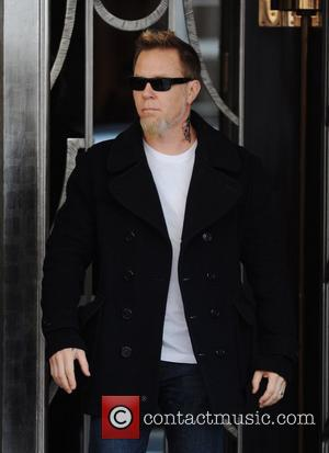 James Hetfield of Metallica greets fans as he leaves Claridge's London, England - 30.03.09