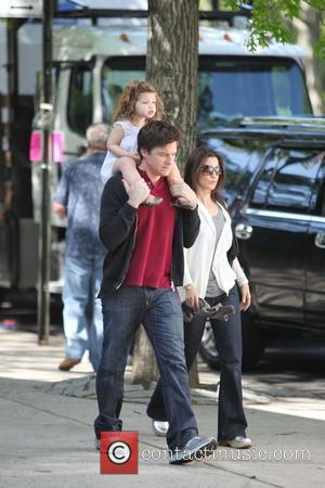 Jason Bateman carries his daughter, Francesca, on his shoulders while walking with his wife Amanda Anka during a break at...