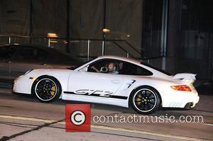 Jason Statham driving his new Porsche 911 GT2 on sunset blvd Los Angeles, California - 01.03.09