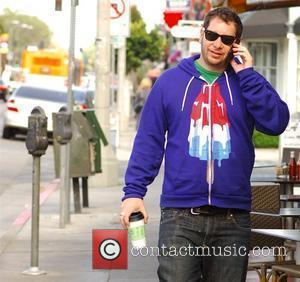 Comedian Jeffrey Ross out and about on his mobile phone wearing a sweatshirt with a giant Bomb Pop popsicle on...