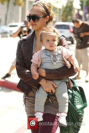Jessica Alba, daughter Honor Marie return to their car after visiting Urth Caffe in West Hollywood and to find they have a parking ticket