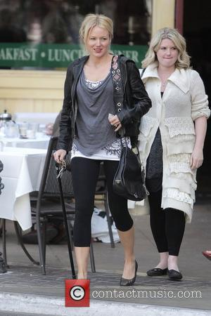 Jewel Kilcher walking with a cane while out shopping at The Grove with a friend Los Angeles, California - 15.04.09
