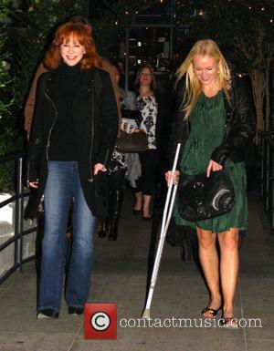 Reba McEntire and Jewel have dinner at STK at West Hollywood. Jewel was walking with a crutch once again following...