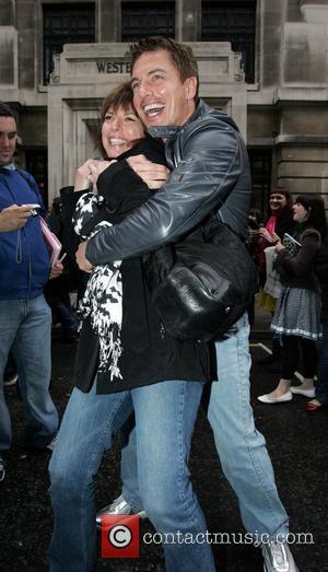 John Barrowman  hugs his sister as he leaves the BBC Radio Two studios. London, England - 11.04.09