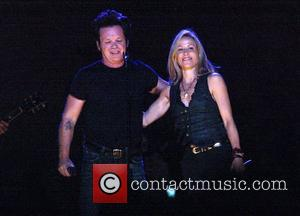 Sheryl Crow and John Mellencamp