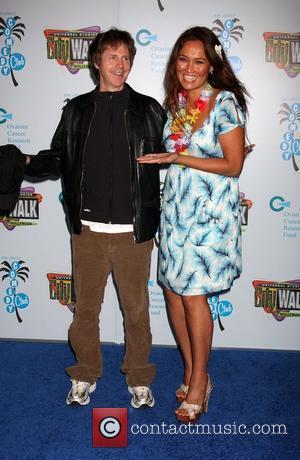 Dana Carvey and Tia Carrere