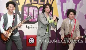 Jonas Brothers waxwork is unveiled at Madame Tussauds, London, England-20.05.09