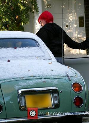 Jane Goldman leaves her house on the day it is announced that her husband has been suspended by the BBC...