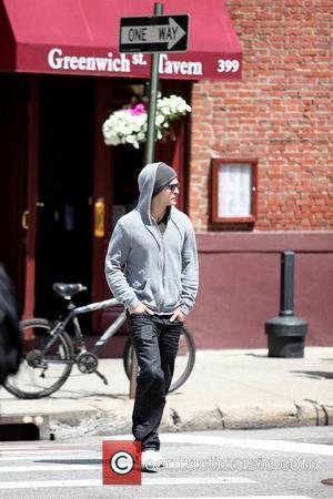 Justin Timberlake  wearing a grey hoodie and sunglasses walking in SoHo New York City, USA - 11.05.09