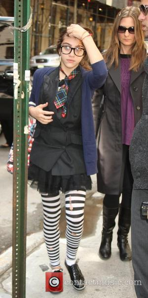 Lourdes Ciccone Leon leaving the Kabbalah Centre wearing a pair of stripey tights and pair of black rimmed glasses. New...