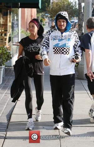 Katie Price and Peter Andres Stop By Starbucks After Finishing A 13.5 Mile Run In Santa Monica.