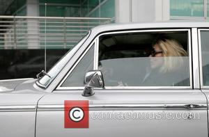Kate Moss arrives at the Ivy restaurant in her 1964 Rolls-Royce Silver Shadow London, England - 20.11.08