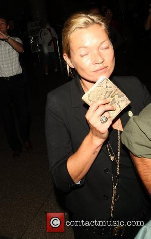 Kate Moss with her boyfriend arriving at LAX airport Los Angeles, California - 30.10.08