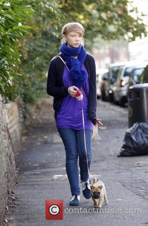 Ekaterina Ivanova takes a little puppy for a walk in North London London, England - 08.10.08
