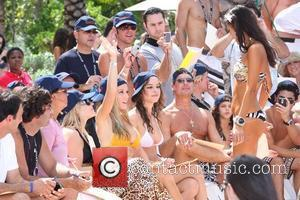 Kendra Wilkinson is lead judge for the swimsuit segment of the 'Sun Fun & 21' event at Cain at the...