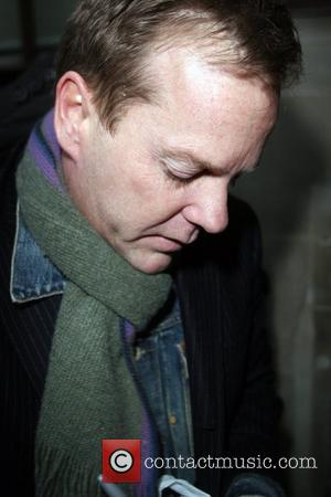 Kiefer Sutherland signs autographs for waiting fans as he leaves BBC Radio 1 after giving an interview on the Chris...