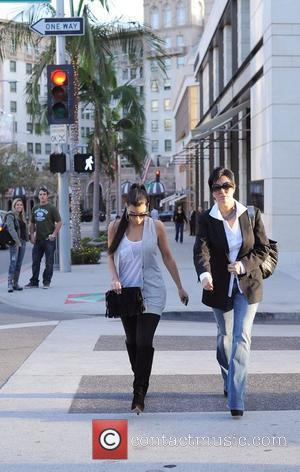 Kim Kardashian and Her Mother Kris Jenner Leaving The Louis Vuitton Store In Beverly Hills