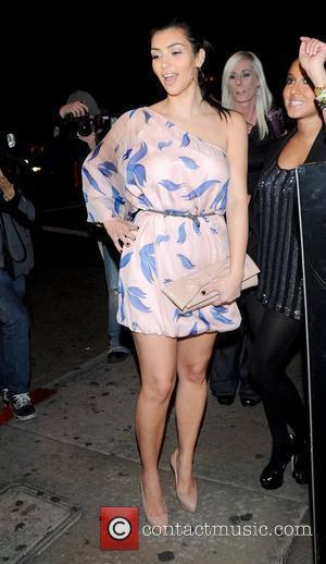 Kim Kardashian and Adrienne Bailon