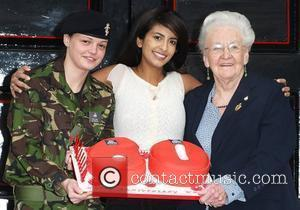 Konnie Huq with the youngest and oldest members of the WRAC 60th Anniversary of the formation of the Women's Royal...