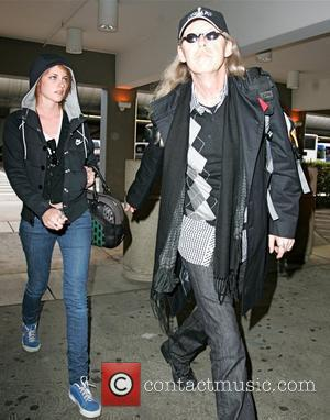 Kristen Stewart arriving at LAX with her father, who didn't seem happy with the presence of the awaiting paparazzi Los...