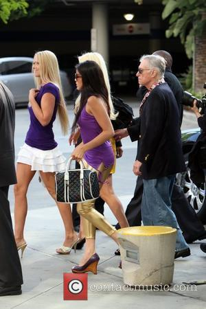 Hugh Hefner and Playmates Celebrities arrive to watch the Los Angeles Lakers game against the Denver Nuggets at the Staples...