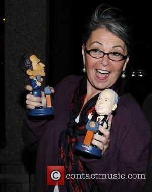 Roseanne Barr  leaving the RTE studios for 'The Late Late' show holding bobble heads of Barack Obama and John...