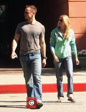 LeAnn Rimes, husband Dean Sheremet, wearing flip flops and leaving a medical building in Bevelry Hills