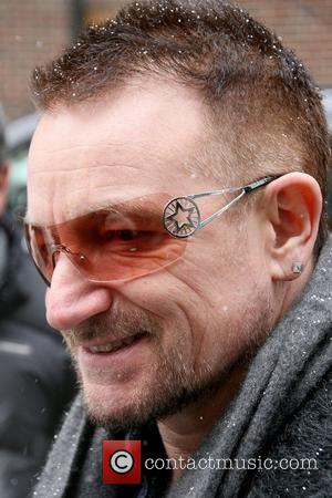 Bono of U2 outside the Ed Sullivan Theater for 'The Late Show with David Letterman' to perform the first of...