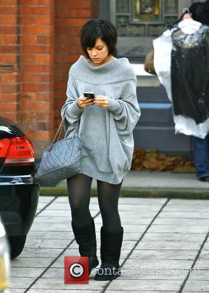 Lily Allen leaves her house wearing Ugg boots and a long, grey sweater dress while texting on her mobile phone...