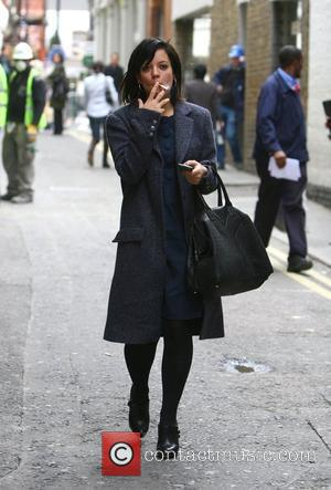 Lily Allen smoking a cigarette as she arrives at Pineapple Dance Studios London, England - 03.10.08
