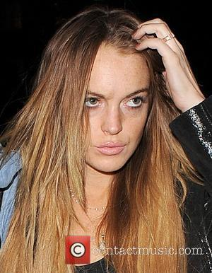 Window Smashed In Lohan-ronson Fight