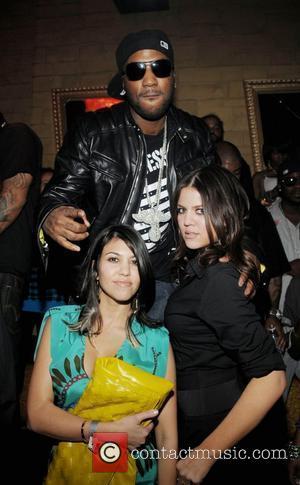 Kardashians Shower Club Crowd With Cash