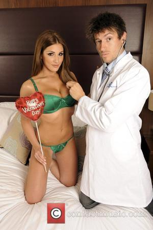 Lucy Pinder and Est's Energy Love Doctor Rob Bell Pose For Valentines Day.